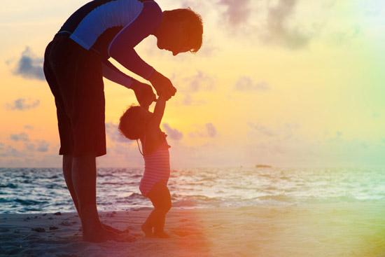 dad-toddler-silloutte-on-beach.jpg